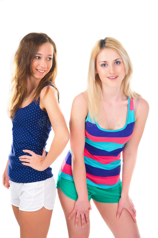 Two young girls in short pants on white background royalty free stock photos