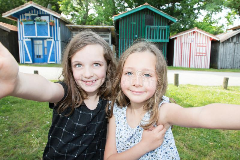Two young girls sisters children make selfie picture royalty free stock photos