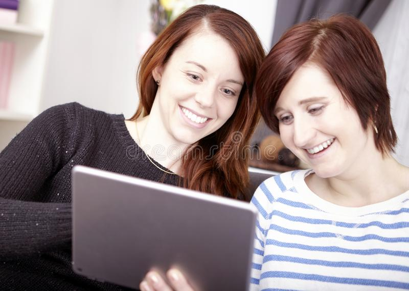 Two young girls with tablet computer royalty free stock photo