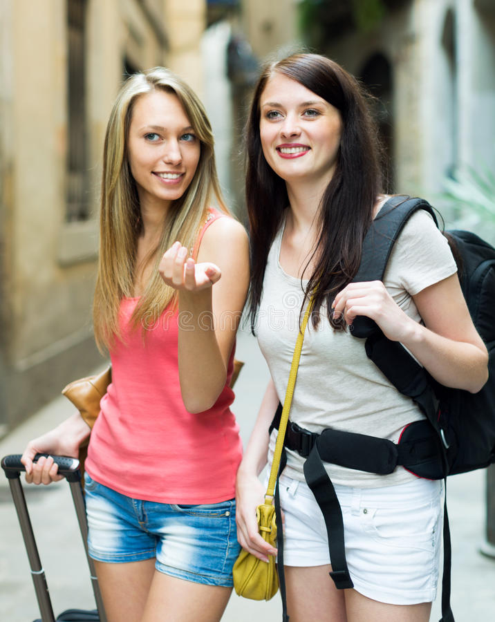 Free Two Young Girls With Baggage Traveling On Vacation Stock Photography - 52251732