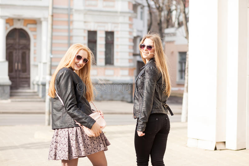 Two young girsl hanging out in the city royalty free stock image