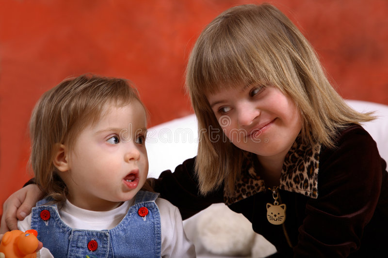 Two Young Handicapped Girls. Two sweet, young, happy girls with Downs Syndrome with wonderful happy expressions royalty free stock photography