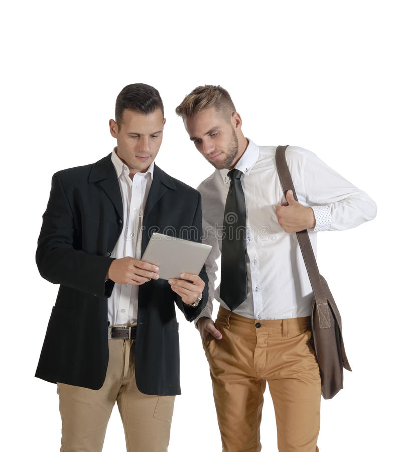 Two young handsome businessmen working with digital tablet. Isolated on white background royalty free stock photography