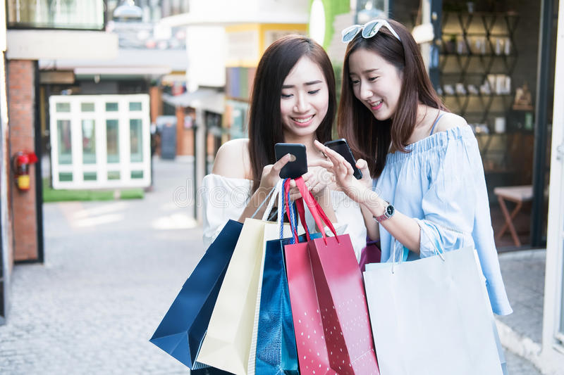 two young happy asian women shopping outdoor shopping mall. royalty free stock photos