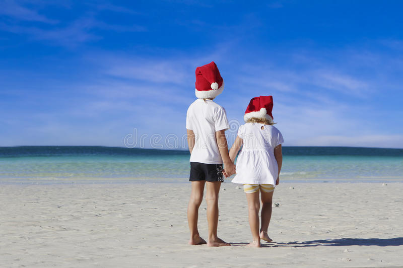 Download Two Young Happy Children In Santa Hats On Tropical Beach Stock Image - Image: 28296539