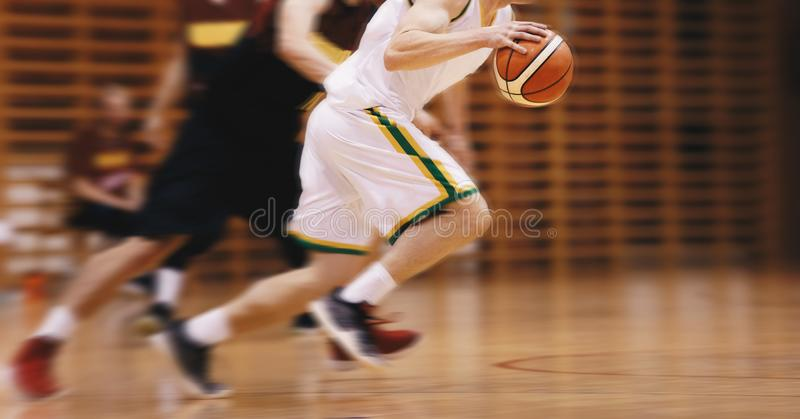 Two Young High School Basketball Players Playing Game. High School Basketball Team stock photos