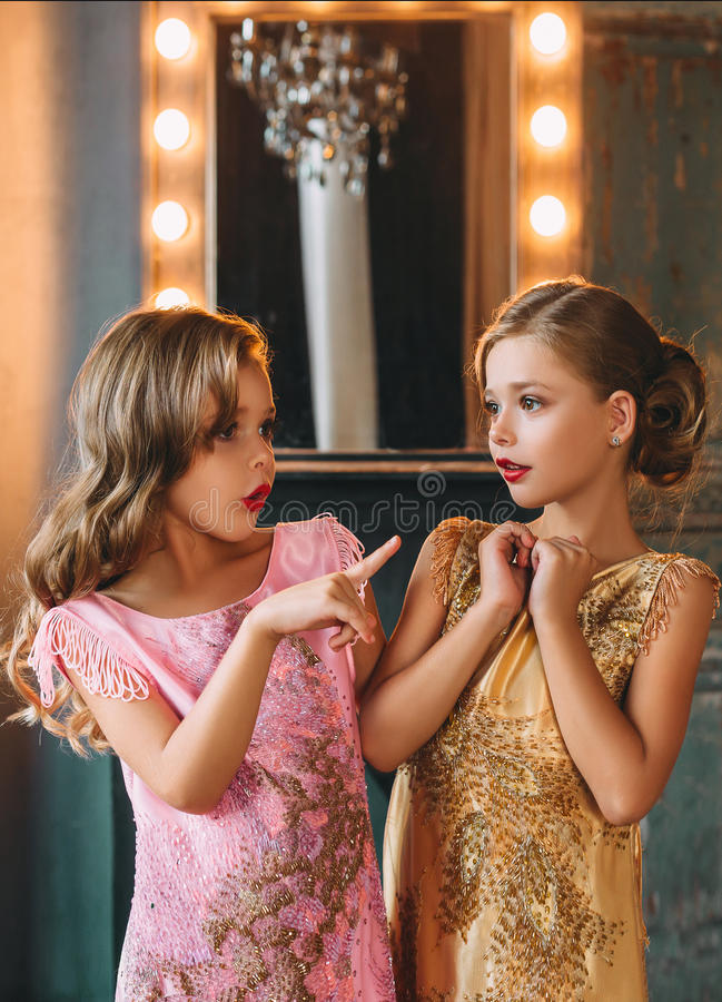 Two young ladies, they conversationally talked. stock image