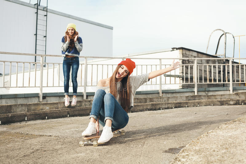 Download Two Young  Longboarding Girl Friends Stock Photo - Image: 34111324