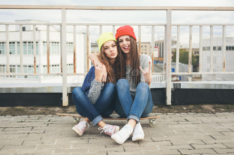 Download Two Young  Longboarding Girl Friends Stock Image - Image of active, pretty: 34110771