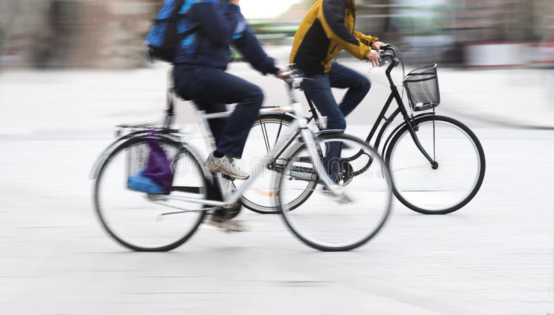 Two young men on bicycles royalty free stock images