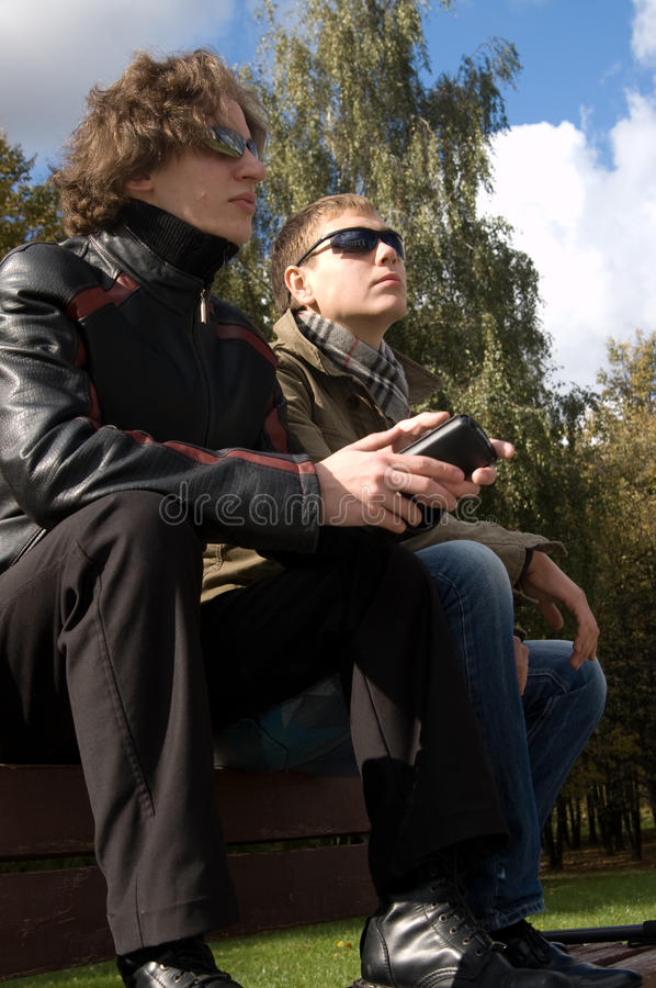 Free Two Young Men On A Park Bench Stock Photography - 11944752
