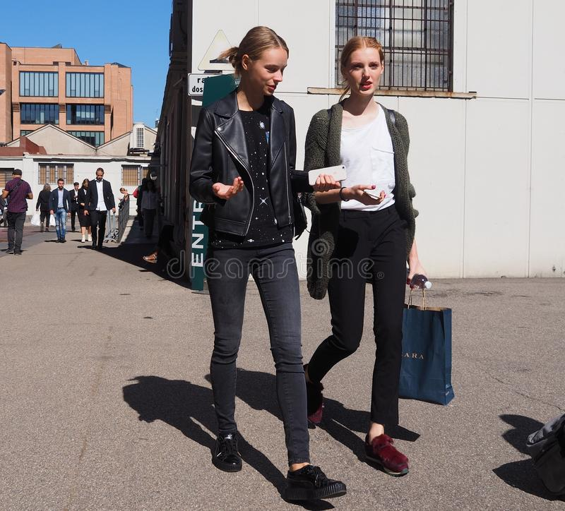 MILAN - SEPTEMBER 21: Two young models walking after LES COPAINS fashion show, during Milan Fashion Week spring/summer 2018. Two young models walking after LES stock photo