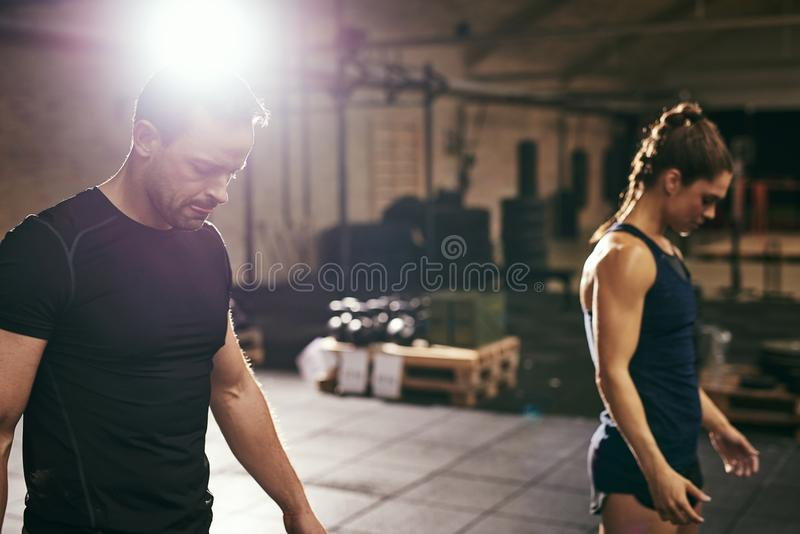 Two young sportspeople training in gym together royalty free stock photos