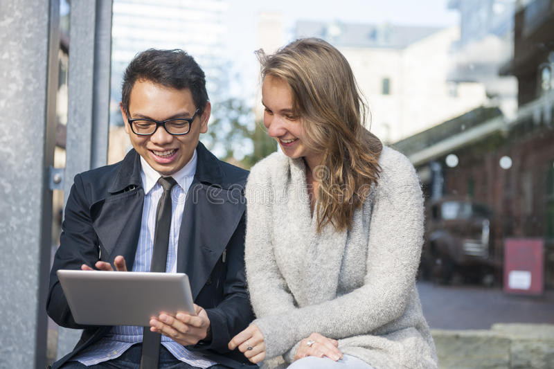 Two young people with digital tablet stock photo