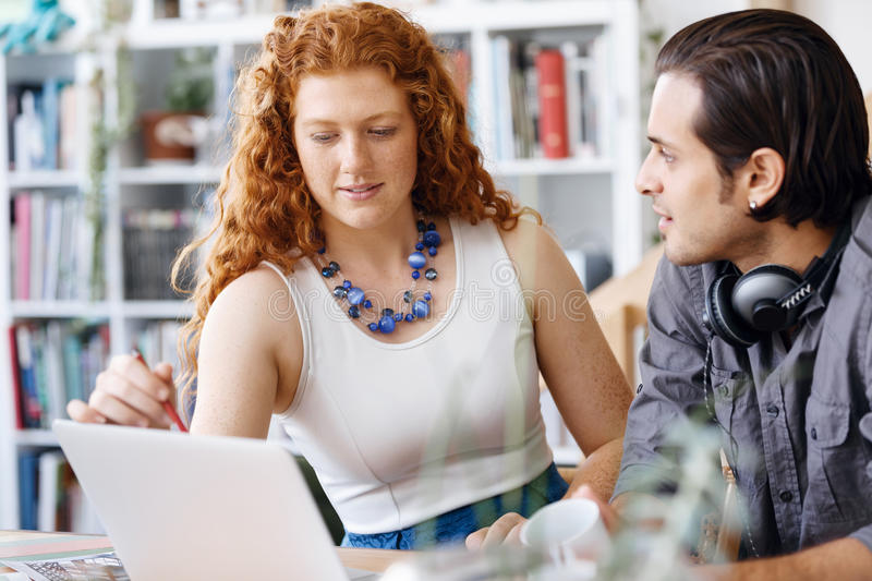 Two young people in office stock image