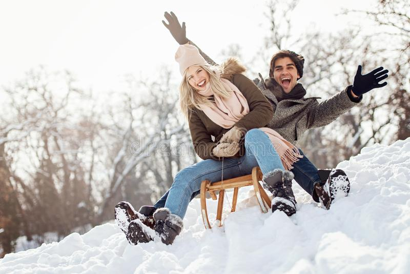 Two young people sliding on a sled royalty free stock photography