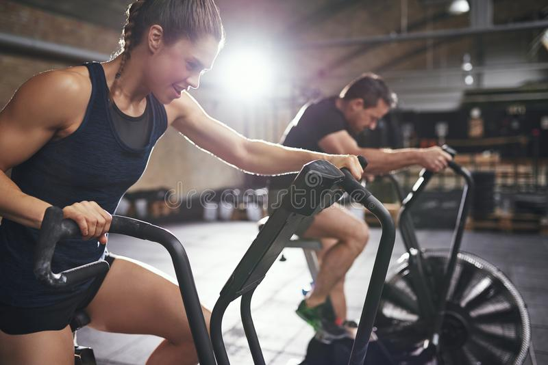 Two young people training toughly on simulators royalty free stock photo