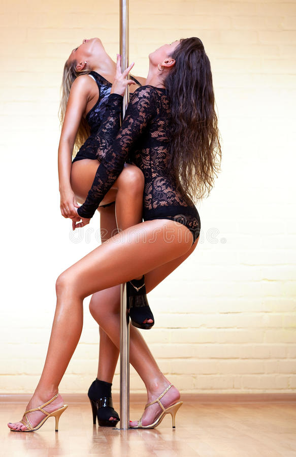 Download Two young women stock photo. Image of glamour, pole, standing - 15918824