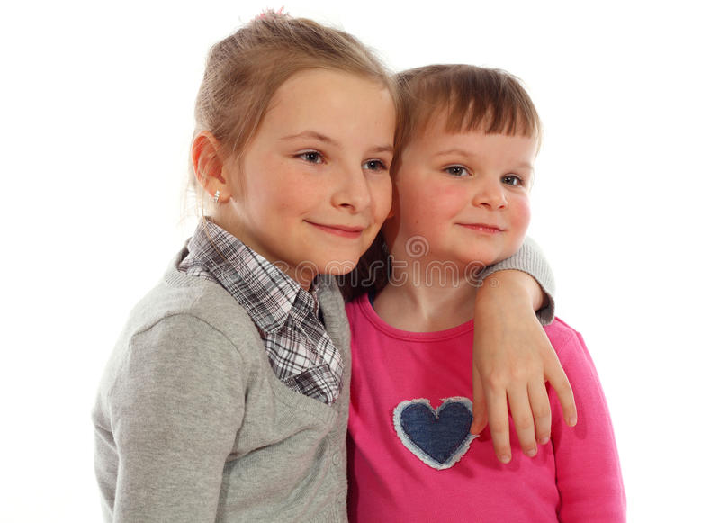 Download Two Young Sisters Posing Together In A Studio Stock Image - Image: 16727653