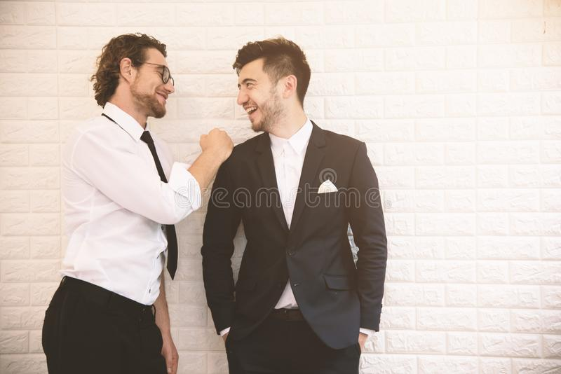 Two young smart businessmen talking together during leisure time at indoor. Business teamwork and coworker concept, Relax concept stock photos