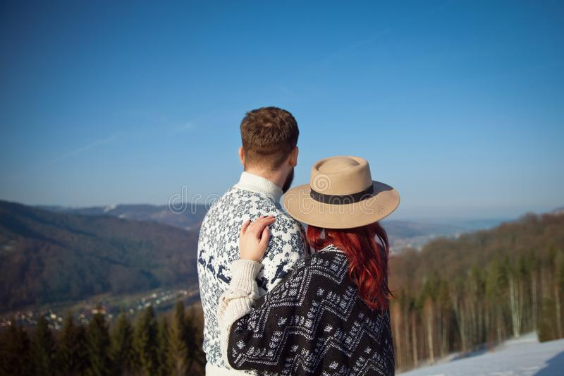 Two young travellers hugging in the mountains stock photography