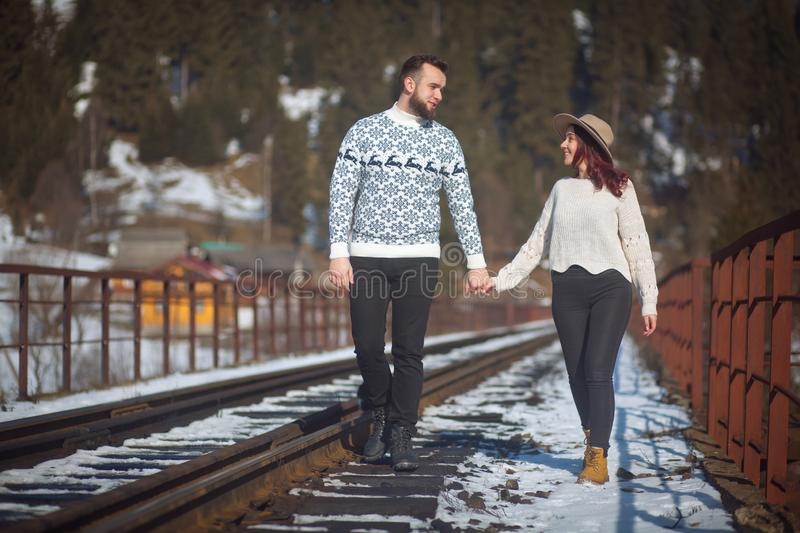 Two young travellers walking on bridge royalty free stock photography