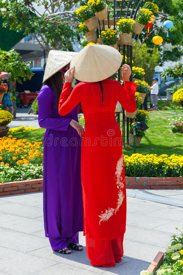 Two young Vietnamese women in traditional Ao Dai dress. Ho Chi Minh City, Vietnam - February 07, 2016: Two young Vietnamese women in traditional Ao Dai dress are stock image