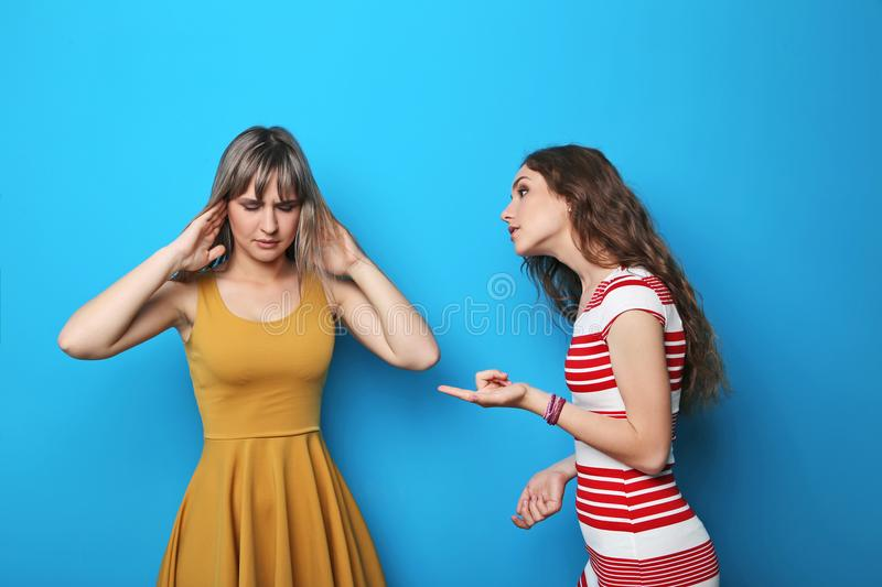 Two young woman. Two young women having an argue royalty free stock image