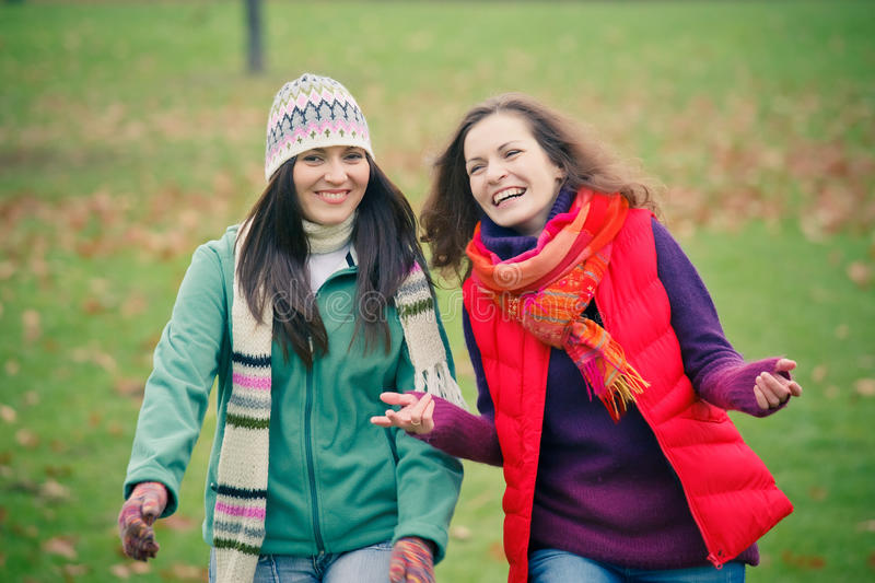 Download Two Young Woman Walking In Autumn Park Stock Photo - Image: 21253606