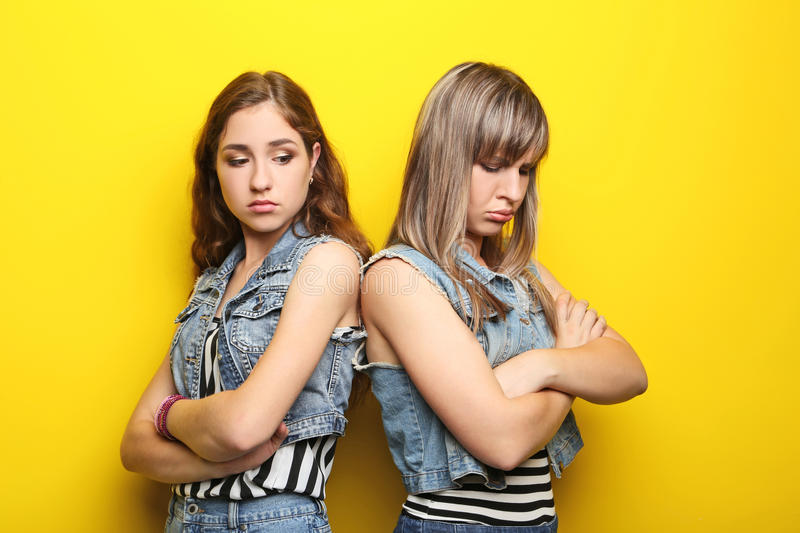 Two young woman. Two young women having an argue stock photos
