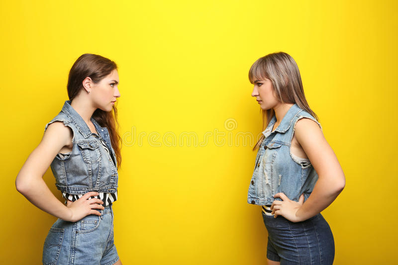 Two young woman. Two young women having an argue stock images