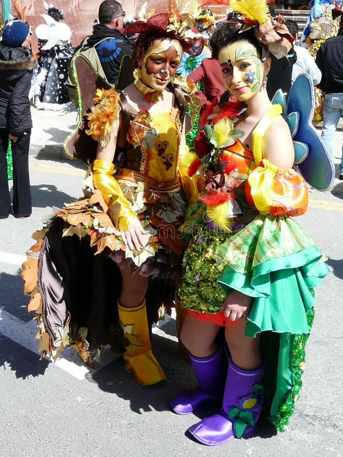 Costumed young women at Malta carnival royalty free stock photo