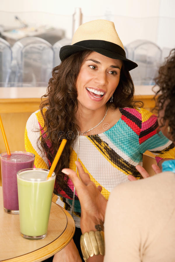 Two Young Women at a Cafe royalty free stock photos