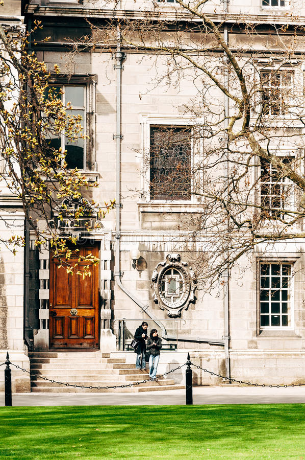 Two young women on campus of Trinity College Dublin stock photography