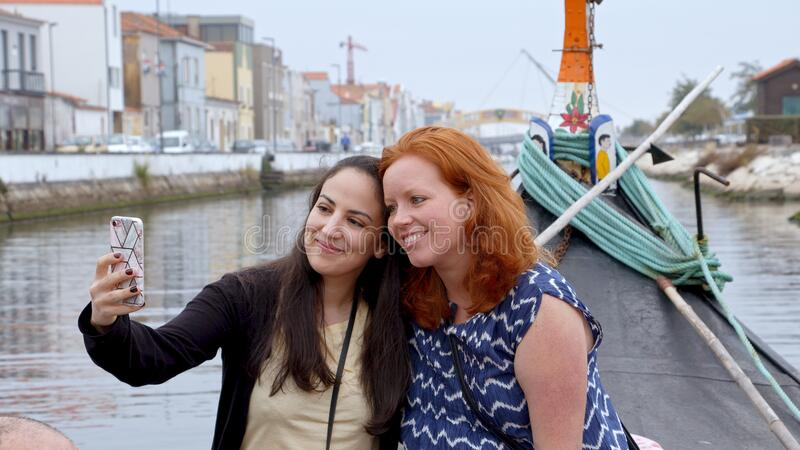 Two young women in the city of Aveiro in Portugal. Travel photography royalty free stock image