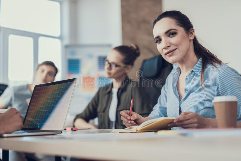 Two young women concentrated on their working tasks royalty free stock images