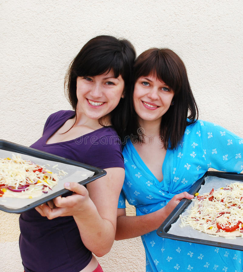 Download Two Young Women Cooking Royalty Free Stock Images - Image: 14818629