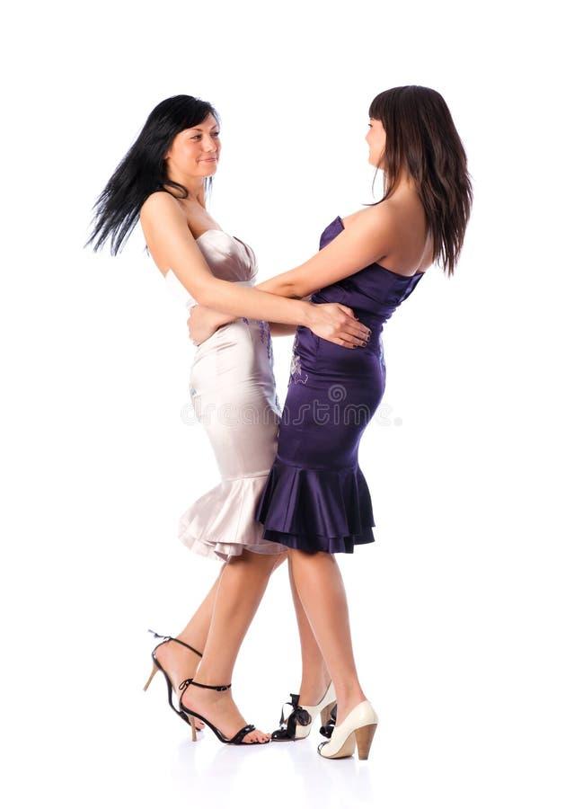 Two young women dancing stock photos