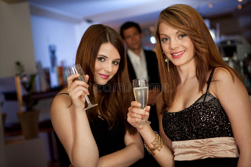 Download Two Young Women Drinking Chanpagne Stock Image - Image of activity, dressed: 16354897