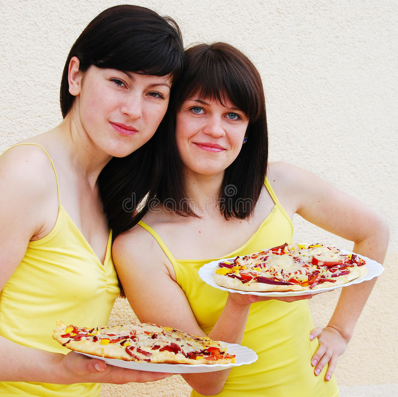 Two Young Women Eating Royalty Free Stock Photos