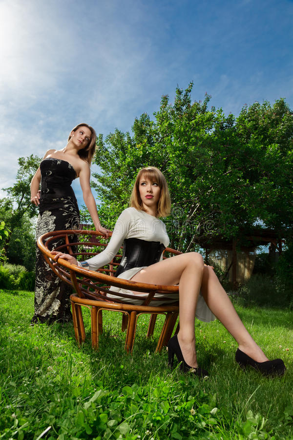 Two young women fashion portrait stock photography