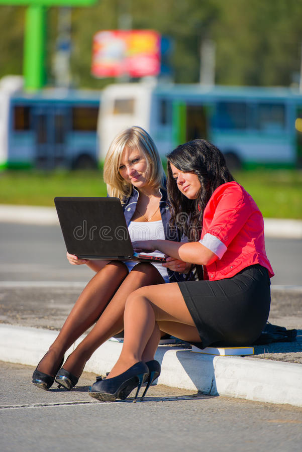 Download Two Young Women Friends Outdoors With A Laptop Stock Photo - Image of outdoors, friendship: 26460194