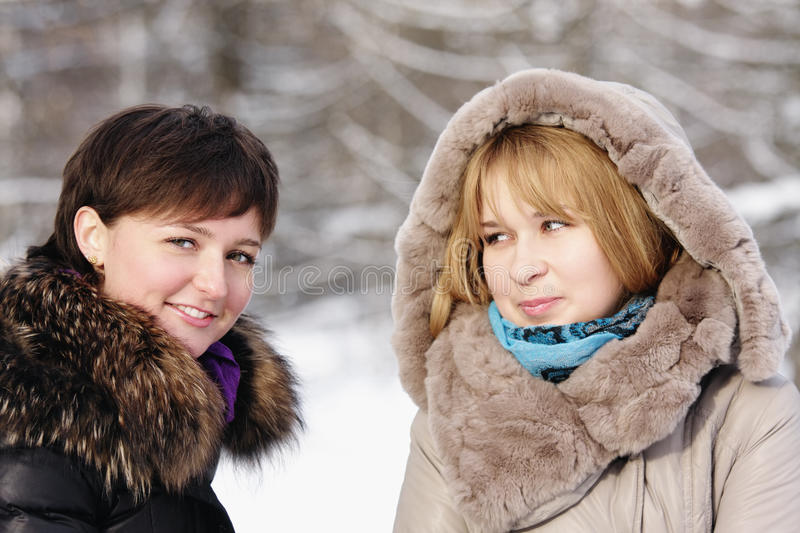Two young women in frosty day