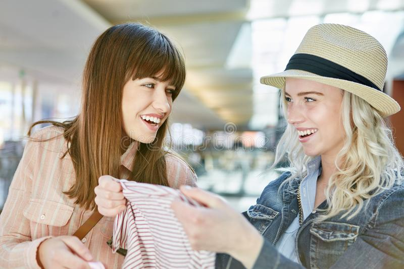 Two young women are happy about their shopping. Two young women enjoy shopping while shopping at retail stock photography