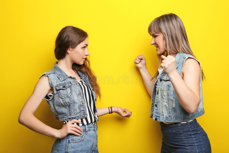 Two young woman. Two young women having an argue stock photo