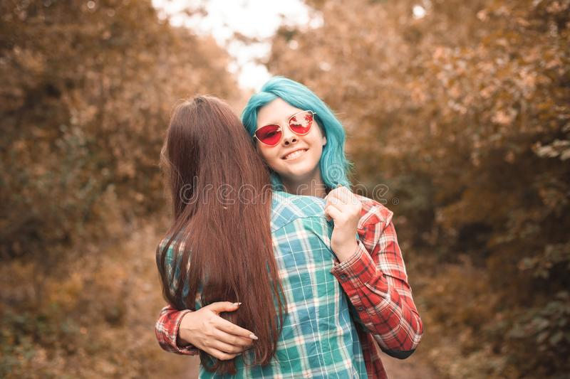 Two young women having fun in forest royalty free stock photography