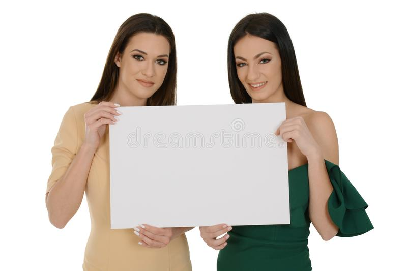 Two young women holding blank board stock images