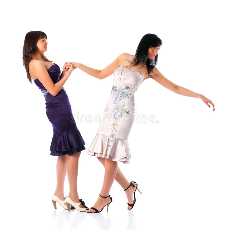Two young women holding hands royalty free stock images