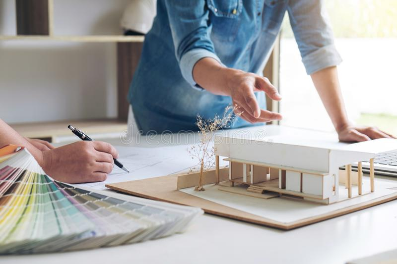 Two young women interior design or graphic designer working on p stock photos