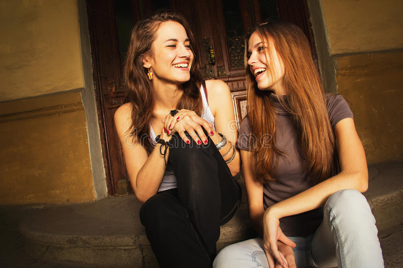 Download Two young women laughing stock image. Image of purple - 26064879